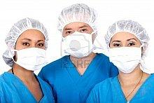 1684326-grupo-de-medicos-cirujanos-o-enfermeros-en-azul-sobre-fondo-blanco