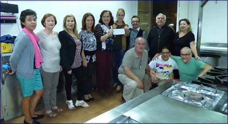 Acto de entrega del donativo de Alba Rociera a Alimentos Solidarios